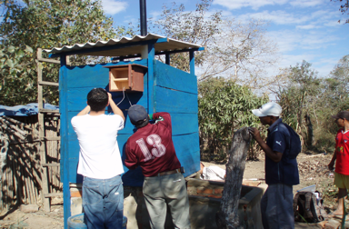 Team working with the solar sanitation system.